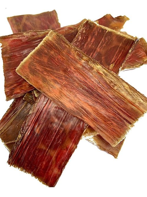 Photograph of dried, large slices of beef jerky with a white background