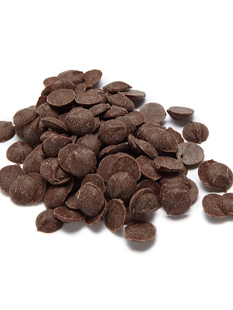 photograph of a pile of dark carob chocolates on a white background