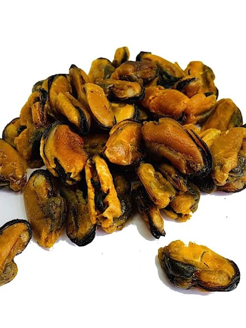 a photograph of dog treat dried Green lip Mussels on a white background
