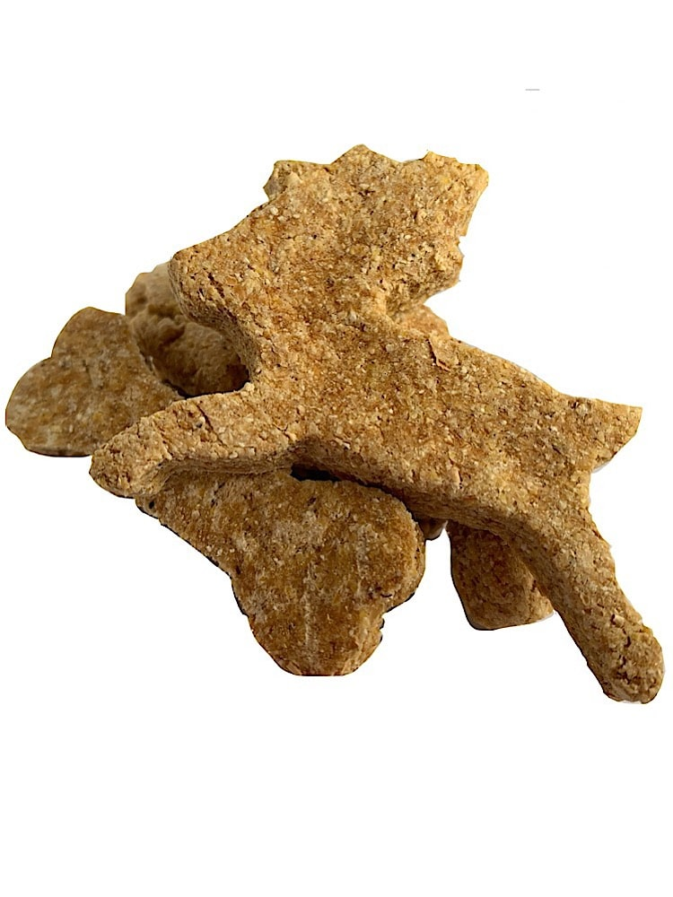 Photograph of a biscuit shaped like a dog bone and a biscuit shaped like a deer on top on each other on a white background