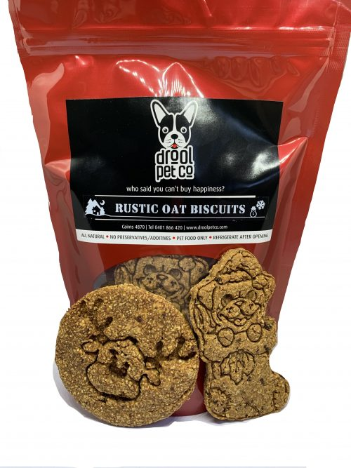 Photo of a red treats pouch with a black Drool Pet Co. label with logo, who said you cant buy happiness and the name of the product. which is rustic oat christmas biscuits.