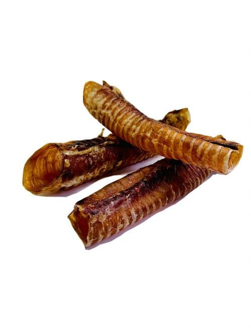 Photograph of three dehydrated beef trachea stacked on top another on a white background.