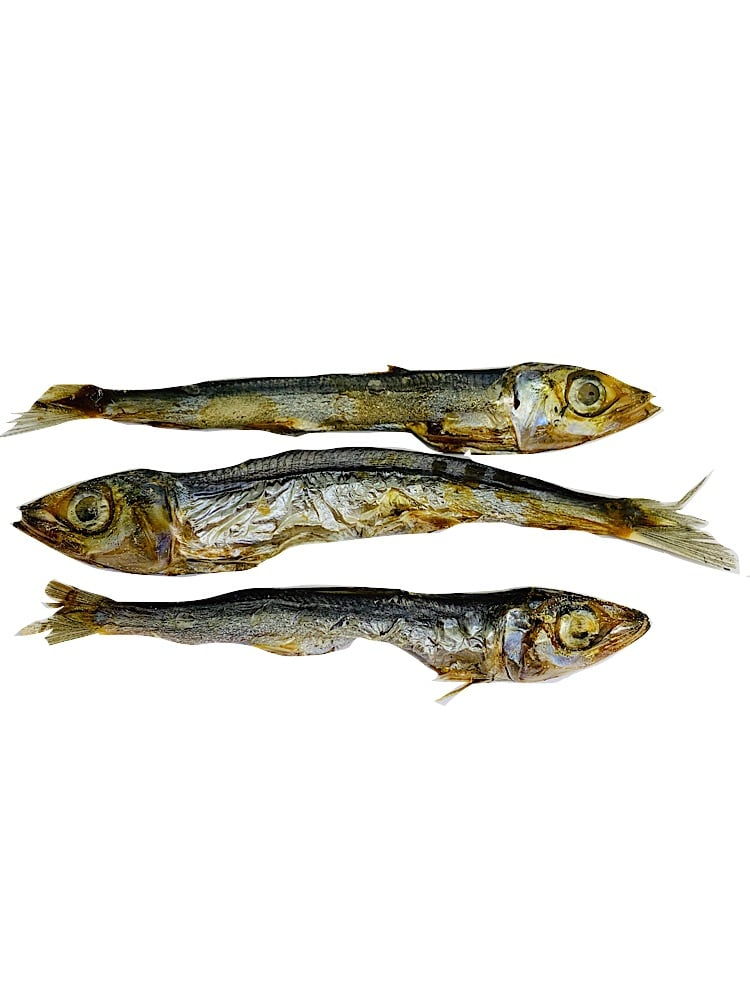 Drool pet Co. dried pilchards. Photograph of three dried pilchard fish dog and cat treats on a white background.