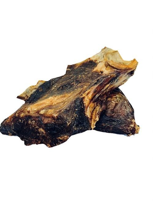 Drool pet Co. Kangaroo Chops. Photograph of two dehydrated kangaroo chops on top of another, on a white background