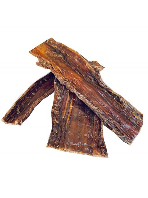 Photograph of three pieces of dehydrated Beef Jerky on a white background.