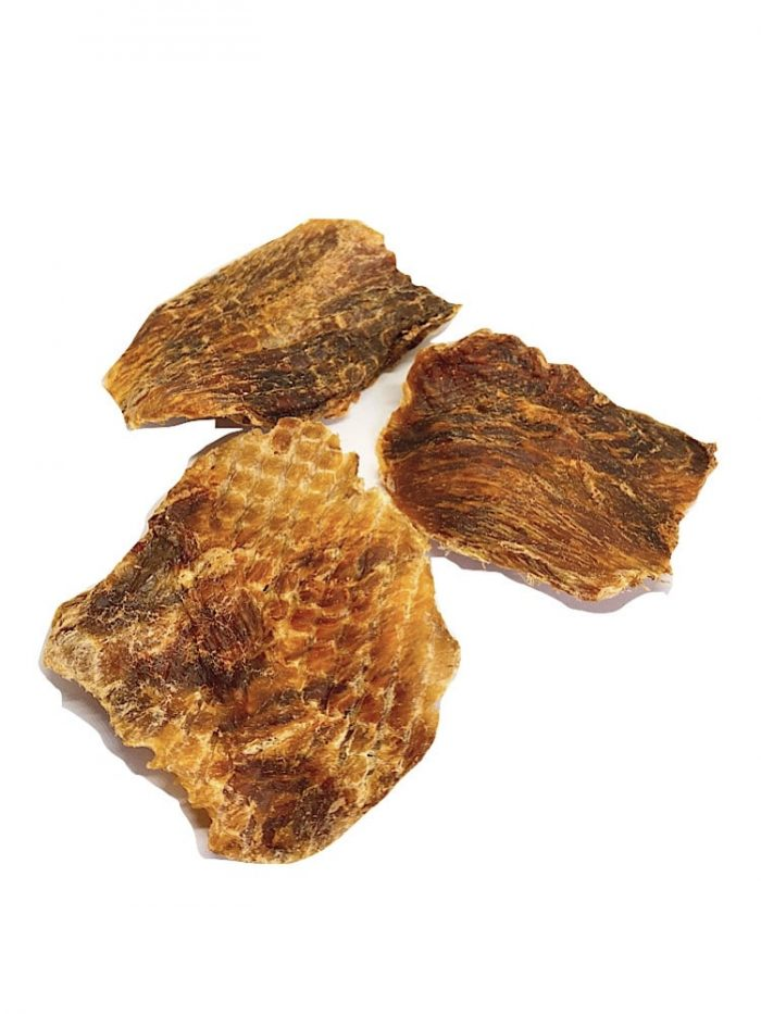 Photograph of three pieces of dehydrated fish Jerky on a white background.