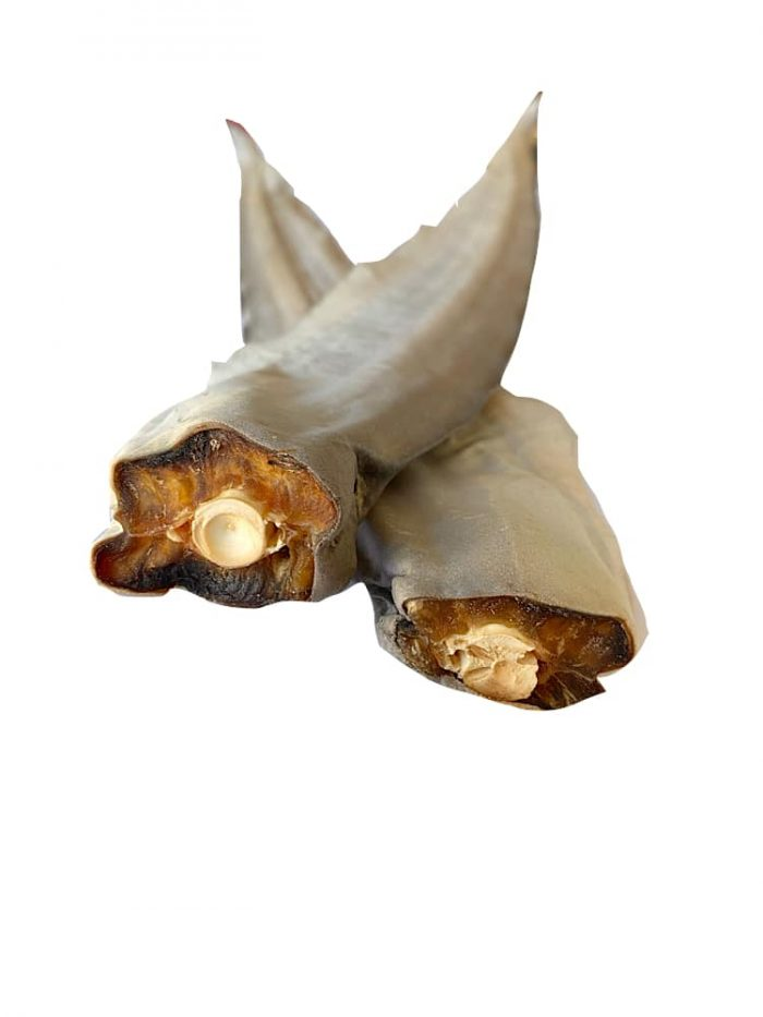 Photograph of a Drool Pet Co. dehydrated shark tails on a white background.