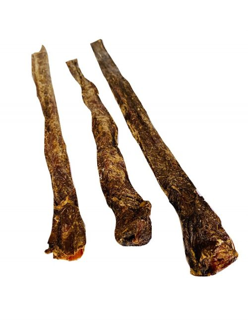 dehydrated beef jerky dog treat sticks on a white background.