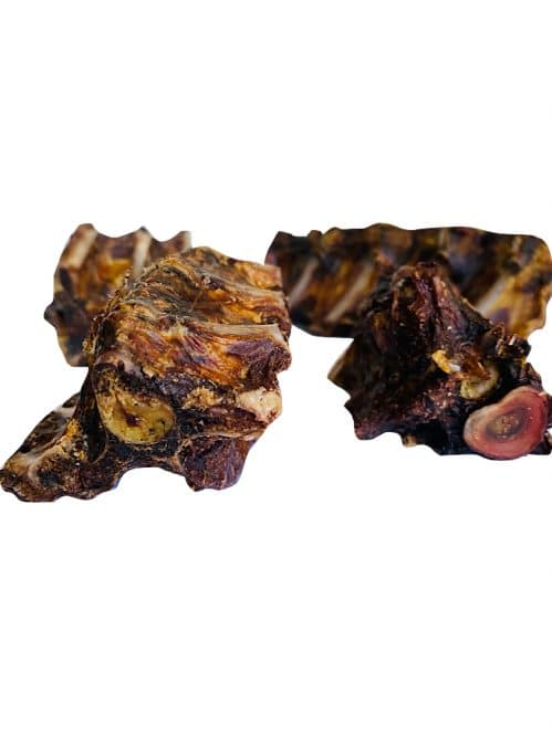 Photograph of a Drool Pet Co. dehydrated Roo tail chunks on a white background.